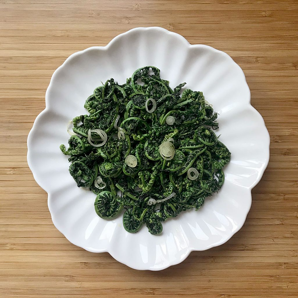 Tiny Trash Can fiddleheads sauteed with wild garlic