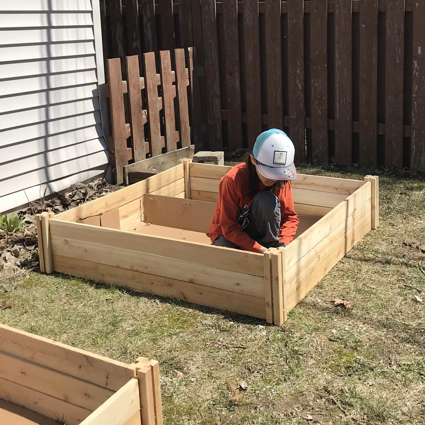 Tiny Trash Can building raised garden beds